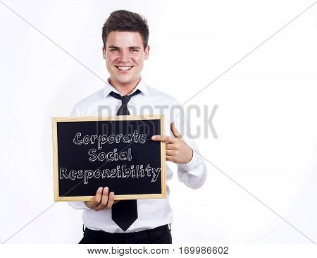 Corporate Social Responsibility Csr - Young Smiling Businessman Holding Chalkboard With Text