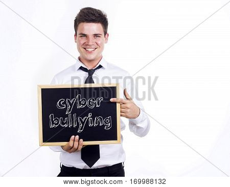 Cyber Bullying - Young Smiling Businessman Holding Chalkboard With Text