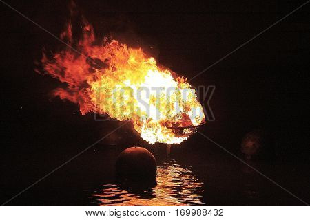 WaterFire brazier in full flame at night