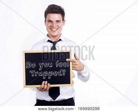 Do You Feel Trapped? - Young Smiling Businessman Holding Chalkboard With Text