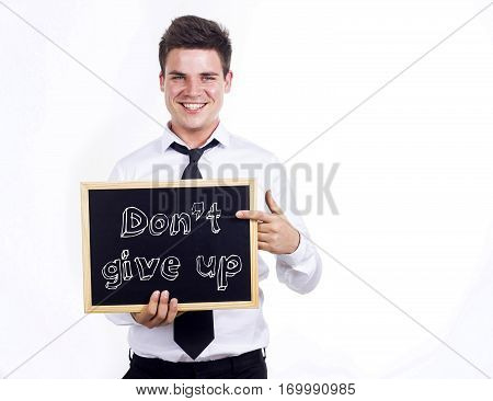 Don't Give Up - Young Smiling Businessman Holding Chalkboard With Text