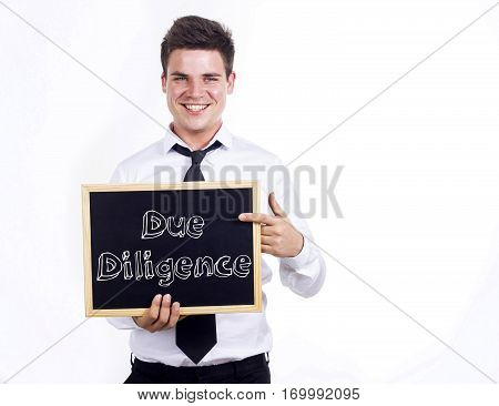 Due Diligence - Young Smiling Businessman Holding Chalkboard With Text