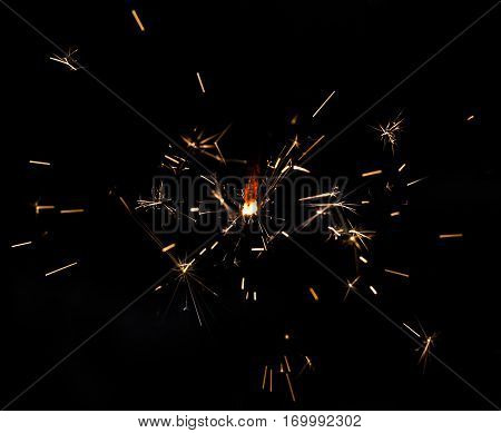 Sparkling fire stick with some particles flying.