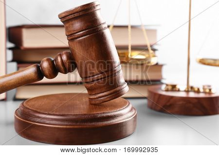 Judge's gavel and books with scales on background