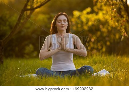 Picture Of Beautiful Woman Doing Yoga At Park