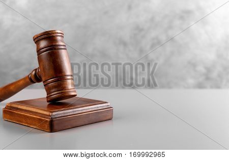Judge's gavel and sound block on wall background