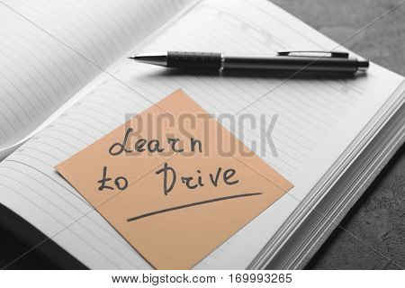 Notepad and note sticker with text. Learn to drive concept