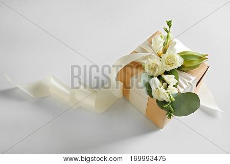 Handcrafted gift box with flowers on white background