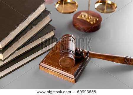 Gavel with books and scales on table