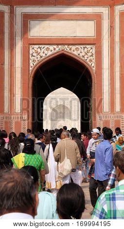 AGRA, INDIA - FEBRUARY 14: Gate to the Taj Mahal (Crown of Palaces), an ivory-white marble mausoleum on the south bank of the Yamuna river in Agra, Uttar Pradesh, India on February 14, 2016.