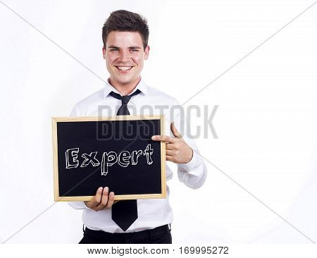 Expert - Young Smiling Businessman Holding Chalkboard With Text