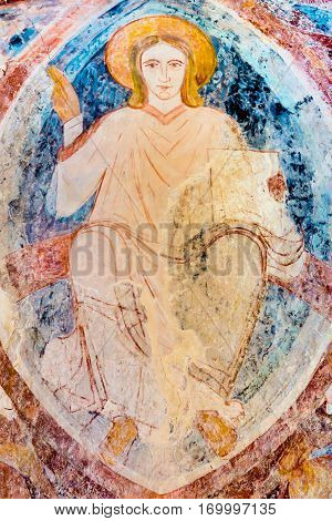 Christ pantocrator sitting on the rainbow, a romanesque wall-painting in ultramarine at Asum church Sweden - May 12 2014