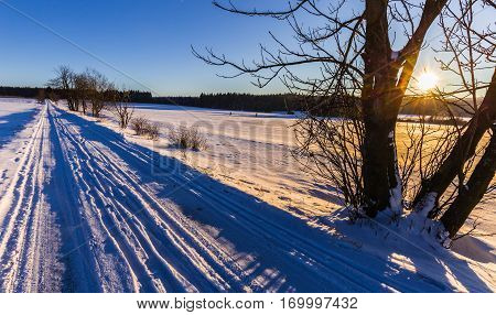 Winter landscape at sunset and road. Moravian landscape Horni Stepanov.