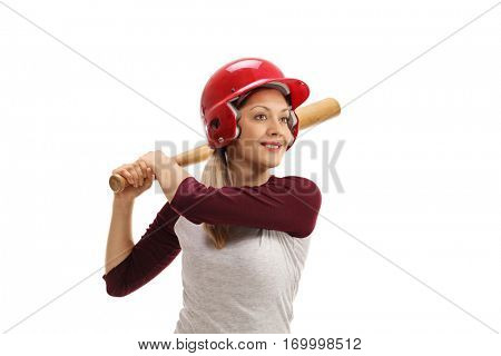 Female baseball player with a wooden bat ready to strike isolated on white background