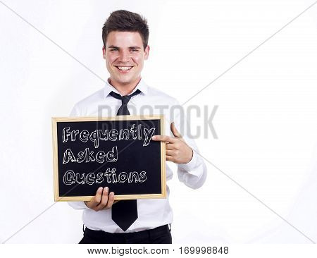 Frequently Asked Questions - Young Smiling Businessman Holding Chalkboard With Text