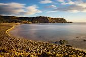 Beach of the Higuerica in the natural place of the Four Calas. Long exposure photography at sunrise on the coast of Aguilas, Murcia. poster