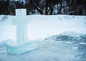 Feast of the Baptism of the Epiphany. Holy cross on the ice. Baptism in the winter. Jordan. poster