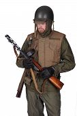 Reconstruction of a Korean War American GI. He wears the 'Armor, Body' vest with helmet and cold weather clothing. poster
