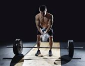 closeup of weightlifter clapping hands before heavy deadlift exercise at the gym poster