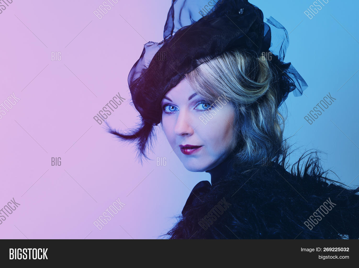 Elegant middle-aged woman in a black hat with a veil and a luxury dress 7a06a4c2c6f4