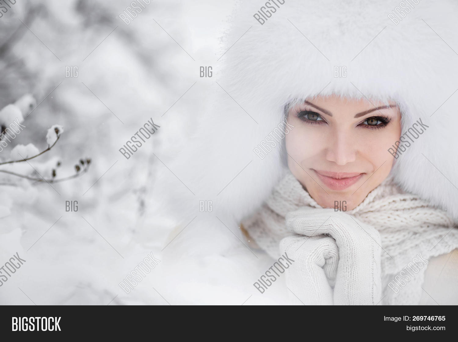 6d31ac345a0e82 Portrait of a cute young woman in a white fluffy fur hat and white scarf in a  white snow-covered park outdoors in winter.Portrait Fashion,beauty,warm ...
