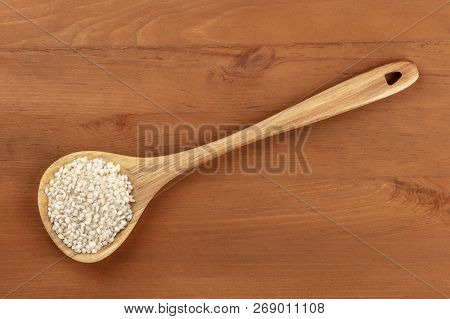 An Overhead Photo Of Spanish Calasparra Rice Used For Paella In A Wooden Spoon, Shot From The Top On