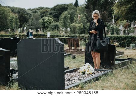 Old woman mourning her husband