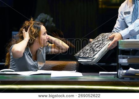 The Boss Gives Pack Of Documents To Busy Manager. Boss Give Extra Work To Executor. Close-up Of Offi