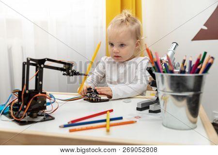 Robotics - Child Playing With Robot Arm