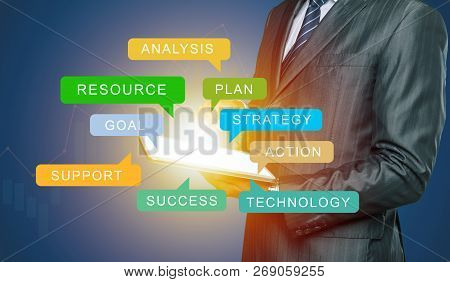 Confident Business Expert. Confident Man In Shirt And Tie Holding Laptop