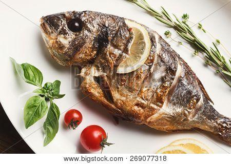 Restaurant Food - Whole Grilled Dorado And Sea Bass On Wooden Restaurant Table, Mediterranean Cuisin