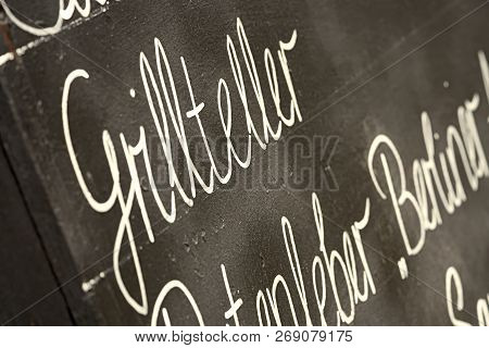 Chalkboard With The Word Mixed Grill (grillteller) In Front Of A Restaurant In Leipzig