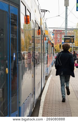 Leipzig, Germany - October 08, 2018: Tram At A Stop In The City Of Leipzig With A Behind Running You