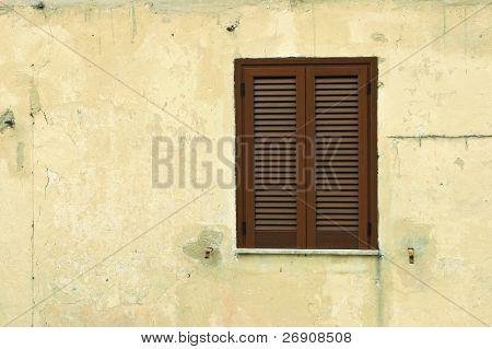 Old shuttered window