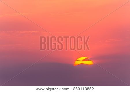 Sun haze in high clouds at sunset over the summer landscape. poster