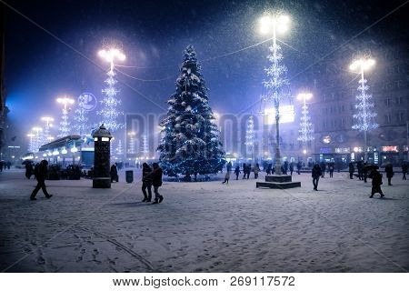 Zagreb, Croatia: January 6 2016: Zagreb Main Square At Night With Blue Lightened Christmas Trees Dur