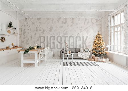 Loft Style Apartment, Large Spacious Living Room With Dining Table And Kitchen. Room With Christmas