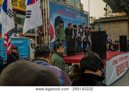 Seoul, South Korea; November 10, 2018: Unidentified Speakers Bow In Prayer At Rally Against The Moon