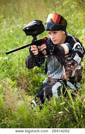 paintball shooter aiming the gun