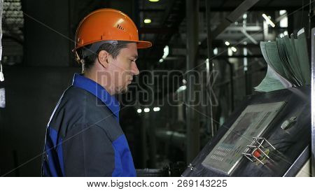Operator Monitors Control Panel Of Production Line. Manufacture Of Plastic Water Pipes Factory. Proc