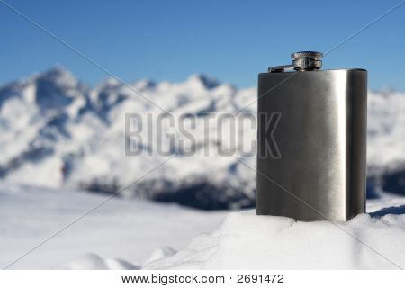 winter season on snowy mountain and silver flask poster