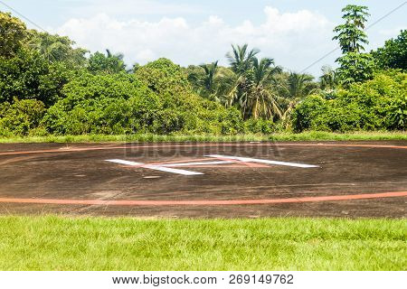 Helipad at Ile Royale, one of the islands of Iles du Salut Islands of Salvation in French Guiana poster