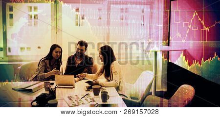 Stocks and shares against photo editors using laptop in meeting room