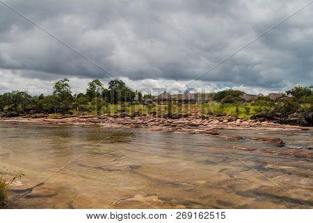 Yuruani River In Gran Sabana Region In National Park Canaima, Venezuela. Indigenous Village In The B