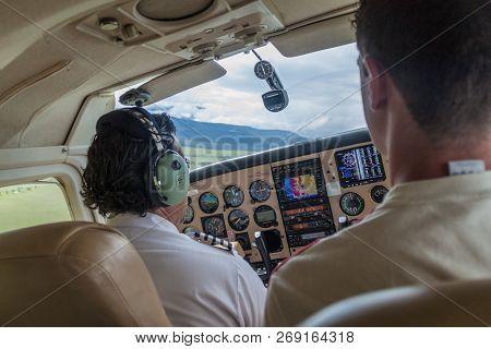 Canaima, Venezuela - August 16, 2015: Pilot Of A Small Cessna 210 Centurion Airplane Heading To Cana