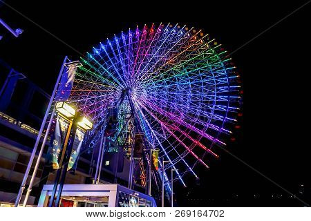 Colorful Neon Lights On Tempozan Giant Ferris Wheel In Night Time At Tempozan Harbor Village, Osaka,