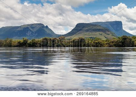 River Carrao And Tepuis Table Mountains In National Park Canaima, Venezuela.