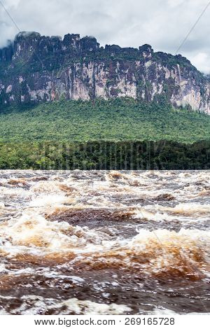 River Carrao And Tepui Table Mountain Auyan In National Park Canaima, Venezuela
