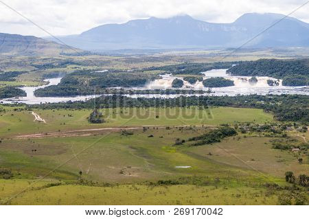 Aerial View Of Canaima Lagoon Waterfalls At River Carrao In Venezuela. Tepuis Table Mountains In The