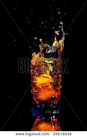 whiskey splash isolated on black